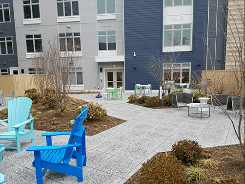 Collaborative Ancilliary Areas Adirondack chair patio outdoor office stack sling chair outside patios rooftops