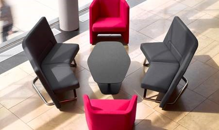 Office furniture that creates a welcoming space, colorful furniture, open floored meeting space